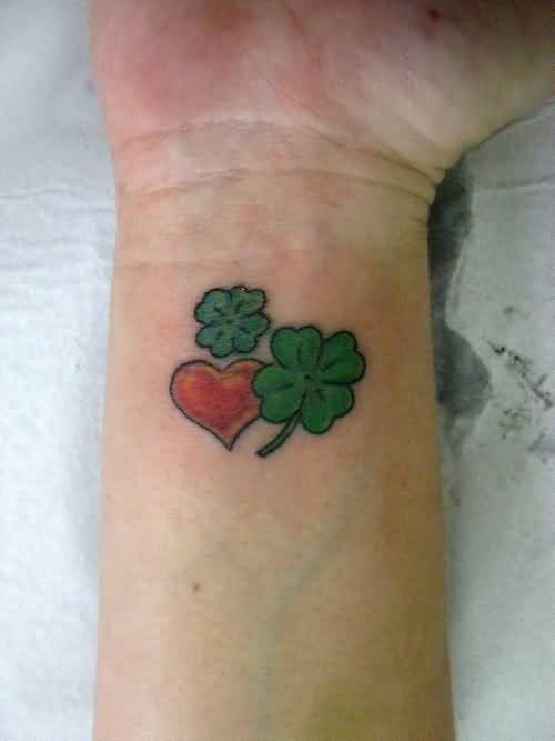 Lovely Red Nice Heart With Nice Green Shemrock Tattoo On Wrist