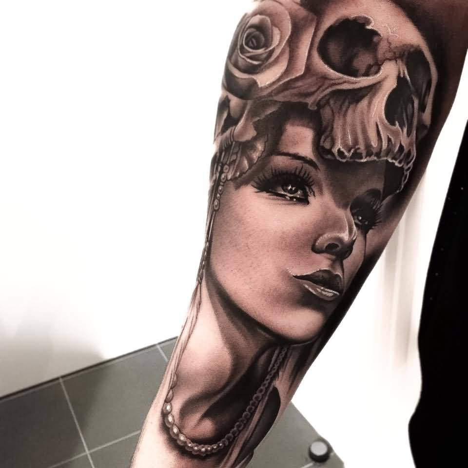 Lower Arm Awesome Skull Girl Face With Roses Tattoo Design By Levi Barnett