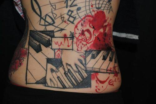 Lower Back Nice And Amazing Piano Keys Tattoo Design