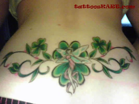 Lower Back flying Fairy With Nice Four Leaf Shamrock Tattoo