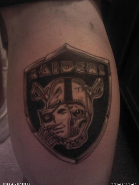 Mask And Skull Oakland Raiders Tattoo On Back Leg