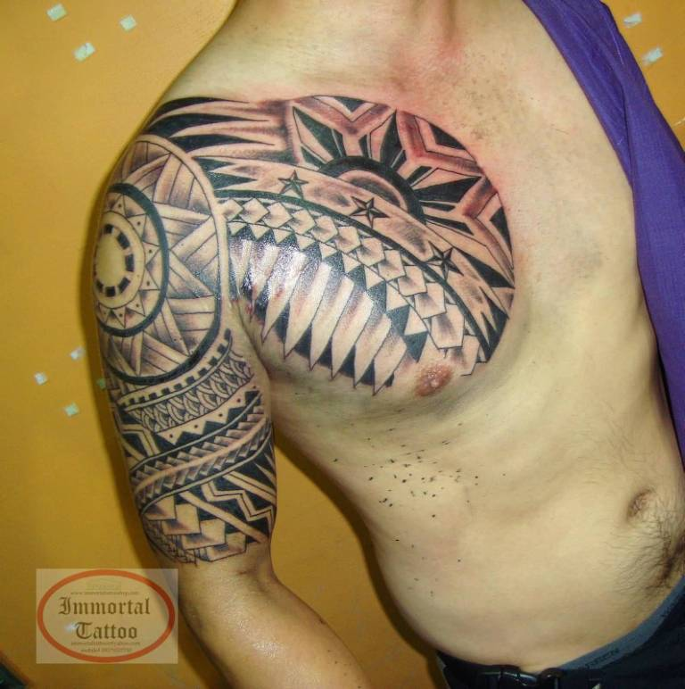 Men Chest And Half Sleeve Filipino Pattern Tattoo