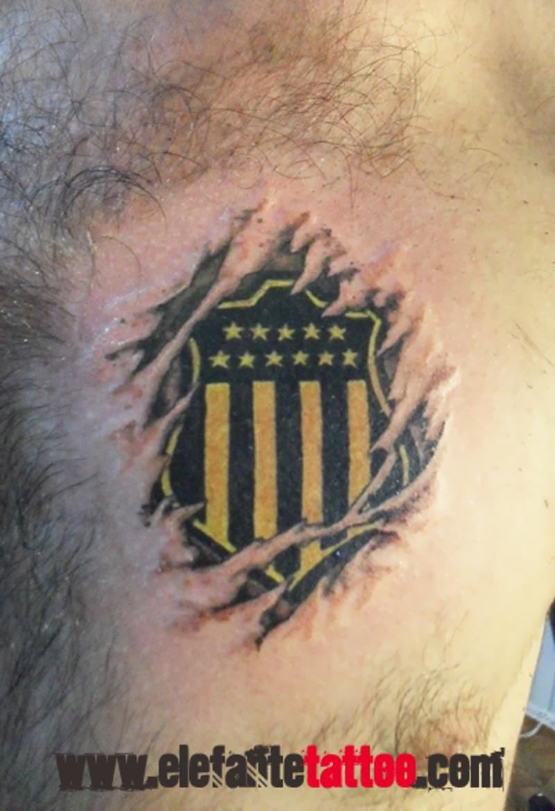 Men Chest Cover Up With Ripped Skin Football Team Logo Tattoo