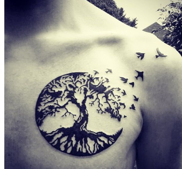 Men Chest Pegan Tree In Cricle With Flying Birds Tattoo