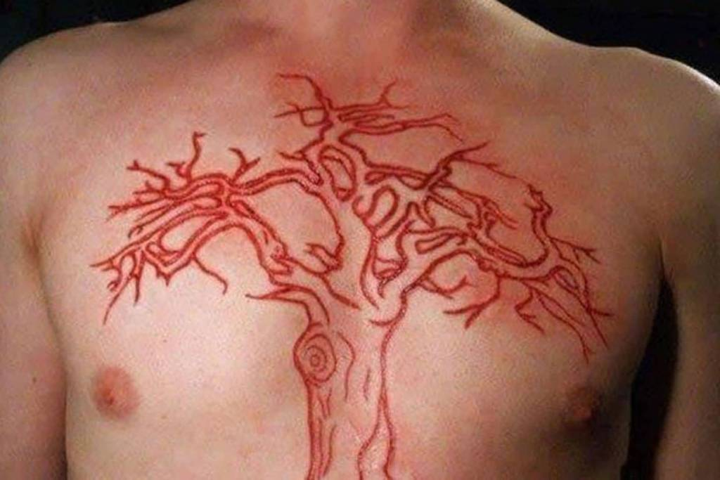 Men Chest Scarification Tattoo Of Tree