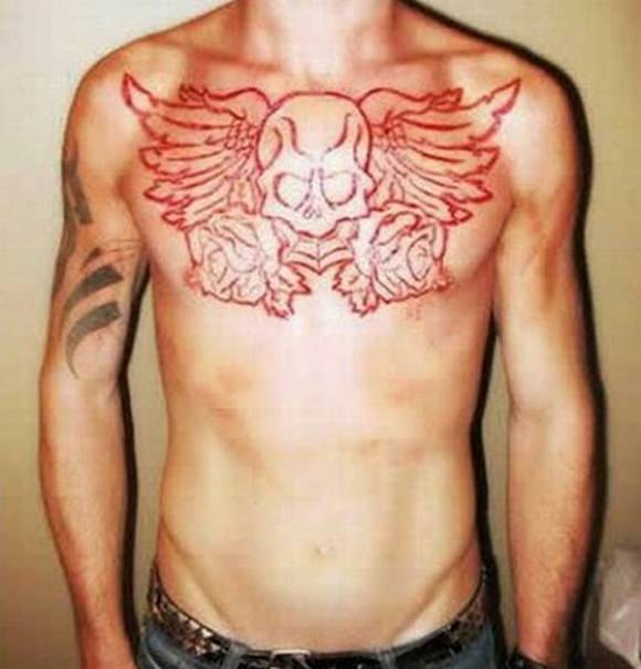 Men Chest Scarification Wings Skull Tattoo