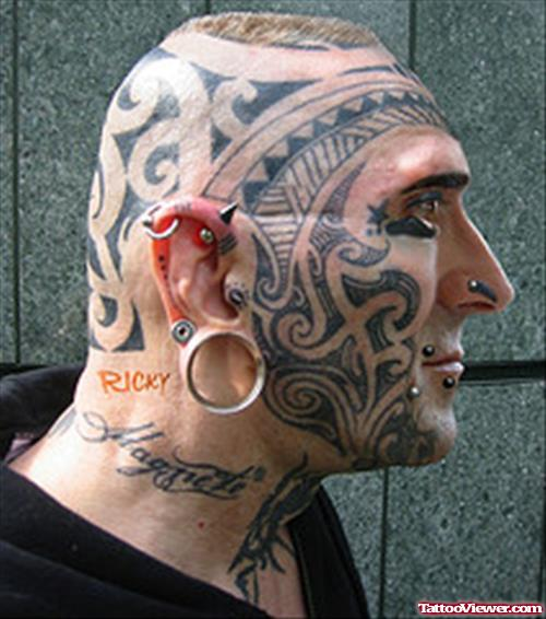 Men Face Extreme Tattoo With Lobe Ear Piercing