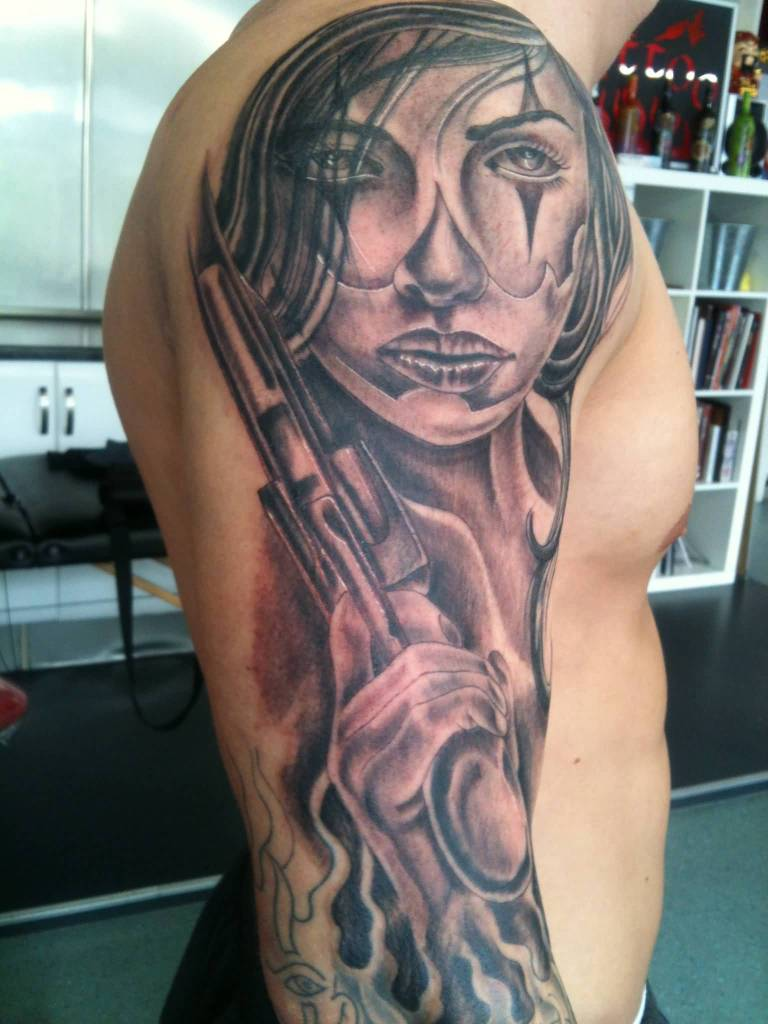 Men Full Sleeve Nice Latino Face And Gun Tattoo