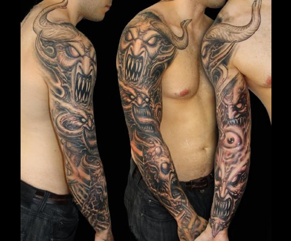 Men Full Sleeve Satan Warrior Face And Eye Tattoo