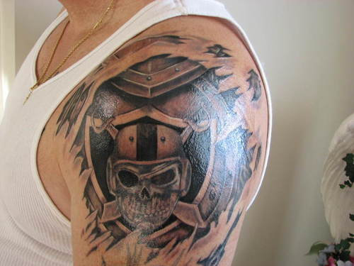 Men HAlf Sleeve Nice Ripped Skin Oakland Raiders Skull Tattoo