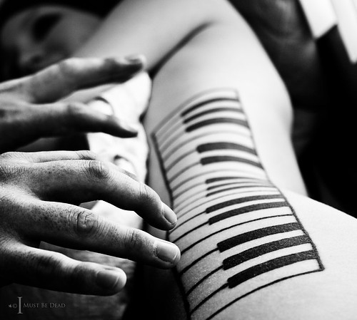 Men Play Piano Keys Girl Rib Side Tattoo
