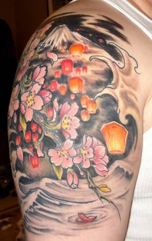 Men Shoulder Nice Flower With Lantern Tattoo