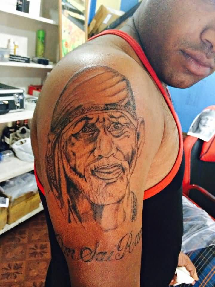 Men Shoulder Nice Sai Baba Face With Letters Tattoo