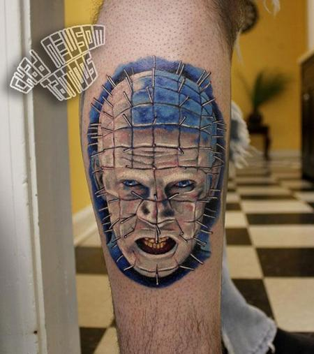Men Show Angry And Scary Pinhead Tattoo Design Idea On Leg
