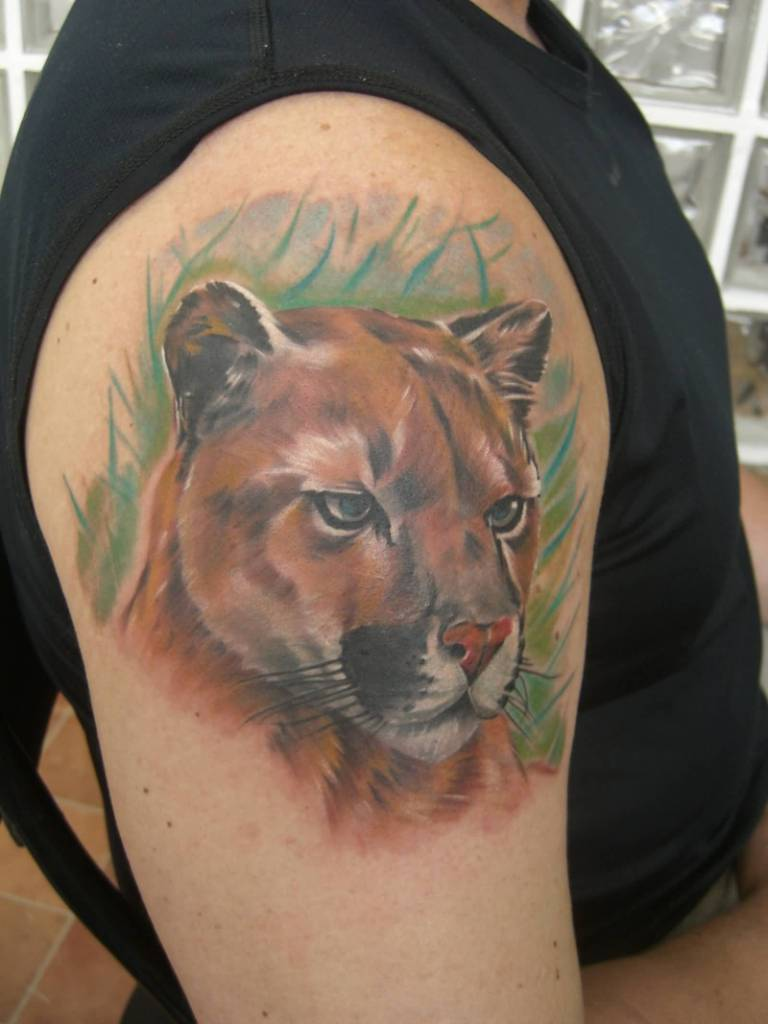 Men Show Awesome And Wonderful Puma Face Tattoo