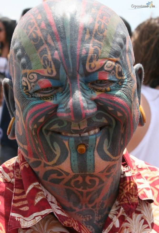 Men Show Colorful Extreme Tattoo On Face
