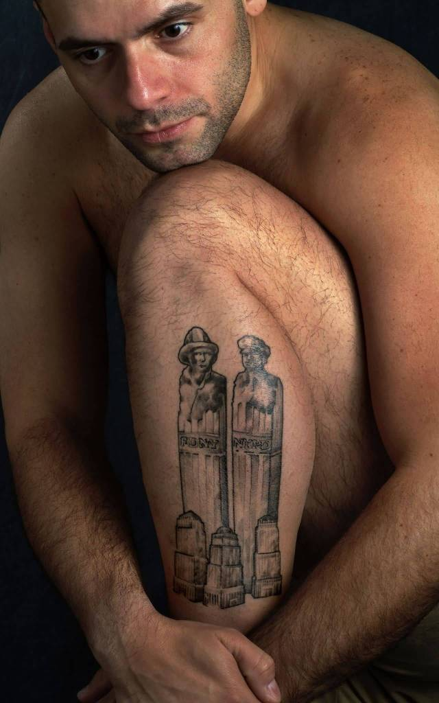 Men Show Grey Ink Historical Statue Tattoo On Leg