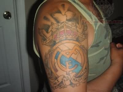 Men Show Her Real Madraid Right Upper Sleeve Tattoo Of Cf Logo