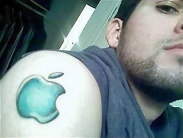 Men Show Nice And Amazing Apple Logo Tattoo Make On Shoulder