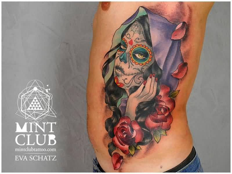 Men Show Nice Colorful Aamzing Catrina Face With Flower Tattoo