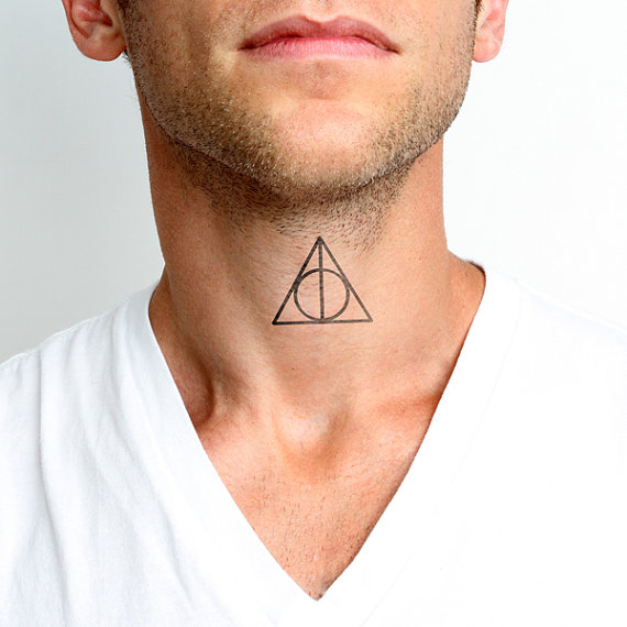 Men Show Nice Deathly Hallows Tattoo