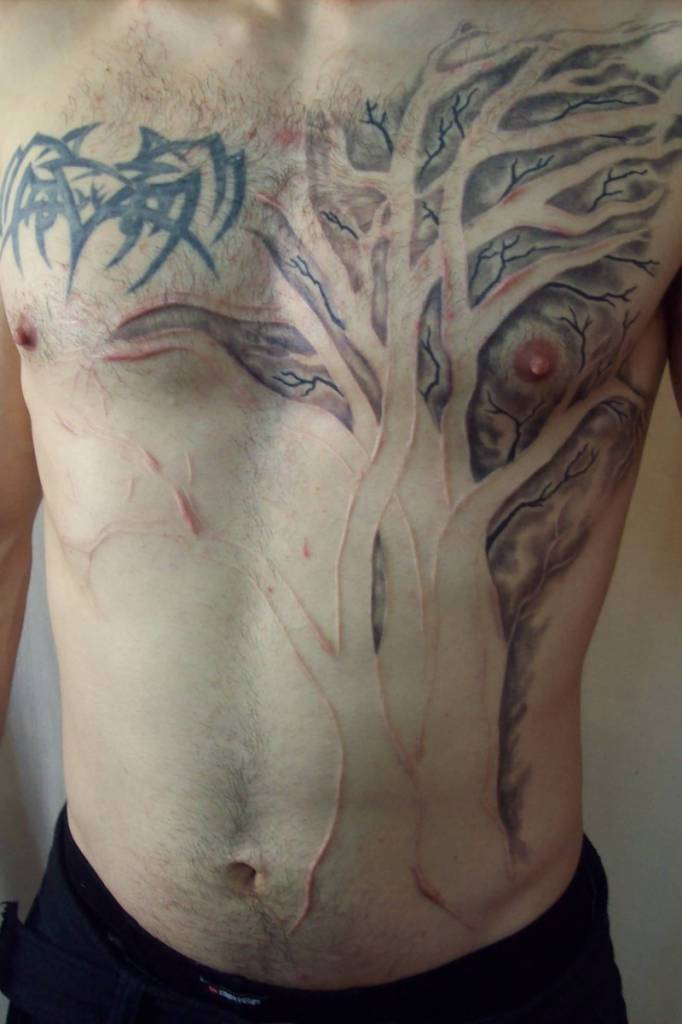 Men Show Nice Scarification Tree Tattoo Design Idea On Front Body