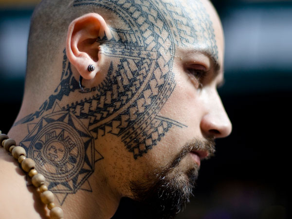 Men Side Face Samoan Tattoo With Ear Piercing