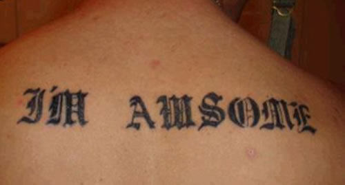 Men Upper Back Black Ink Nice And Amazing Latino Letters Tattoo