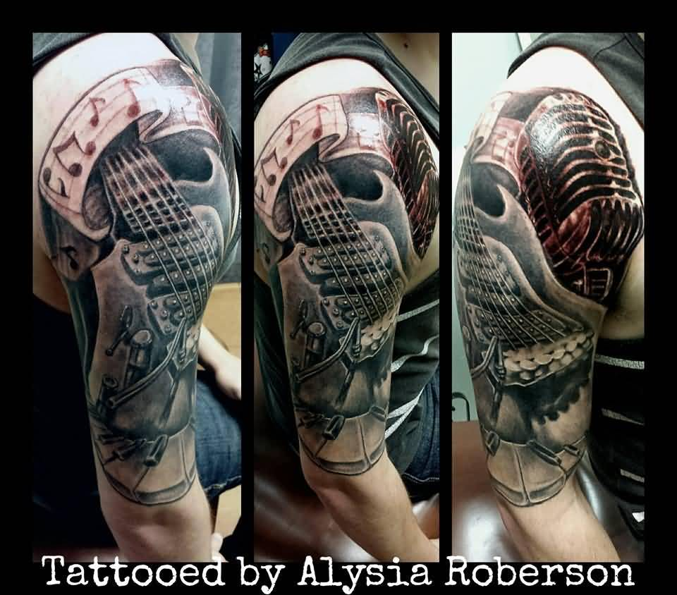Mic With Awesome Piano Keys And Guitar Tattoo On Half Sleeve