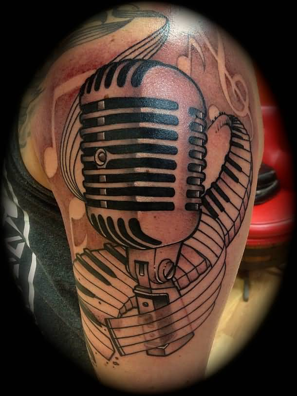 Microphone And Nice Piano Keys Tattoo Design Idea On Shoulder