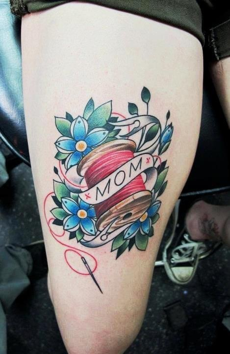 Mom Banner With Nice Flower And Spool Tattoo On Thigh