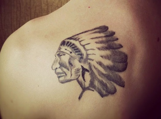 Native Indian Cutural Face Historical Tattoo On Upper Back
