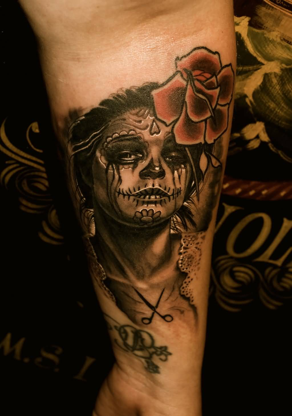 Nice And Amazing Catrina Face And Rose Tattoo Design On Forearm