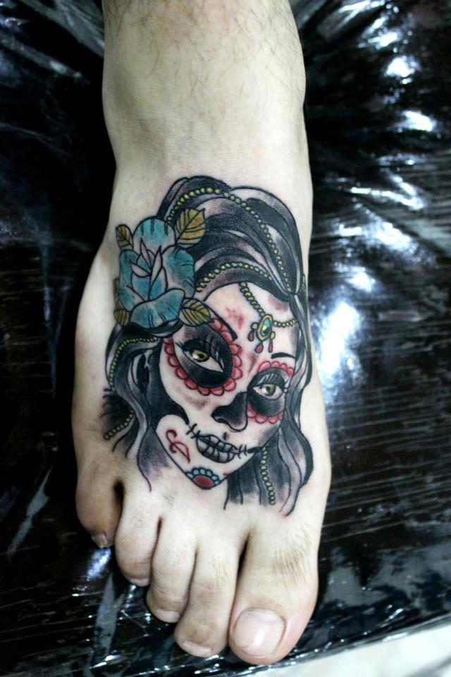 Nice And Amazing Catrina Girl Face Tattoo On Women Foot