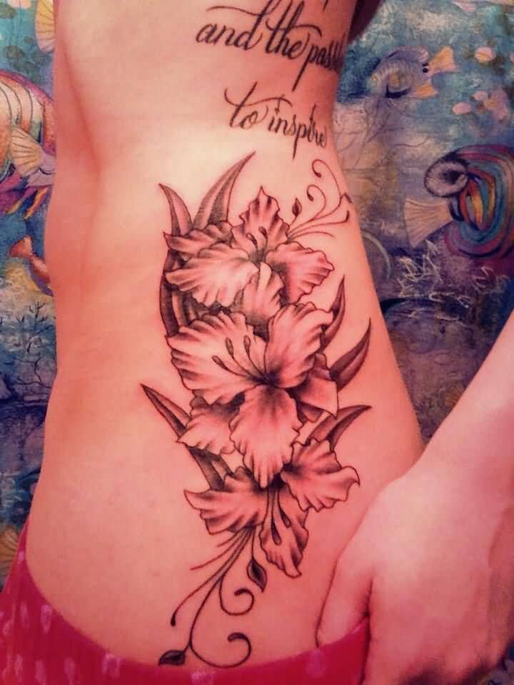 Nice And Amazing Gladiolus Flower With Lertters Tattoo