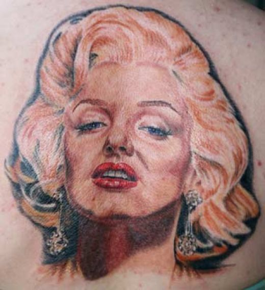 Nice And Amazing Marilyn Monroe Portrait Face Tattoo Design