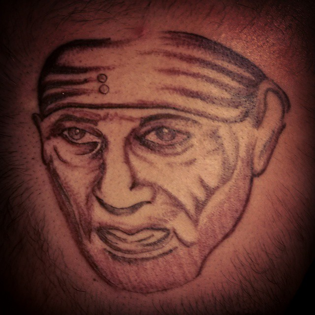 Nice And Amazing Sai Baba Face Tattoo