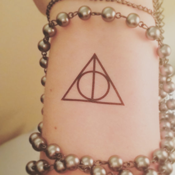 Nice And Simple Hallows Artifical Tattoo Make On Wrist