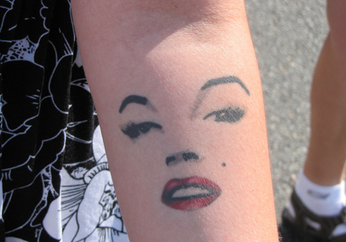 Nice And Simple Marilyn Monroe Forearm Face Tattoo