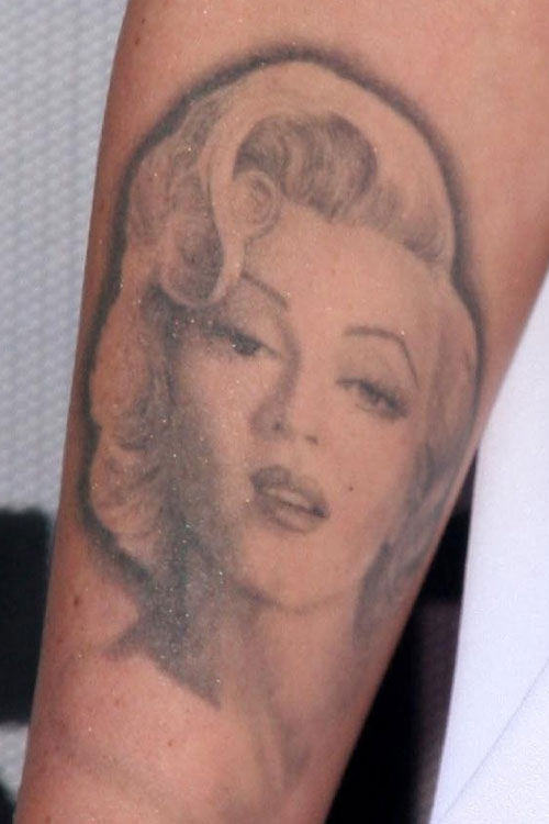Nice And Simple Marilyn Monroe Portrait Face Tattoo