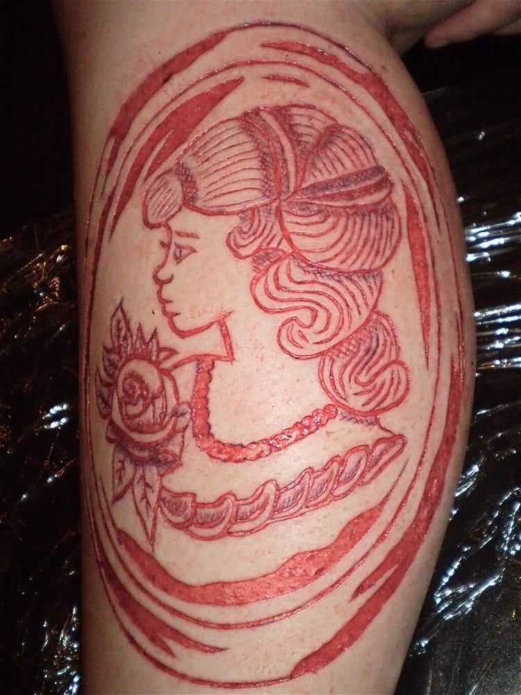 Nice And Simple Scarification Girl Face With Flower Tattoo