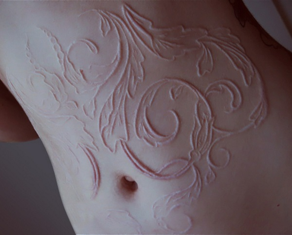 Nice And Simple Scarification Tattoo Design Idea On Girl Belly