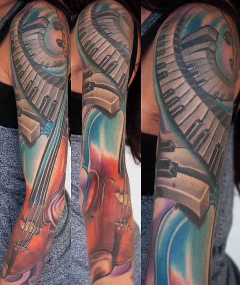 Nice Awesome Guitar Piano Keys Tattoo For Full Sleeve