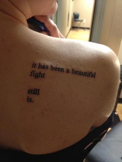 Nice Beautiful Small Poem Tattoo Design On Girl Back Right Shoulder