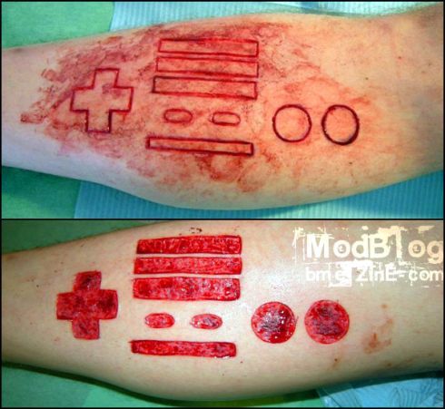 Nice Before And After Scarification Maths Signs Tattoo
