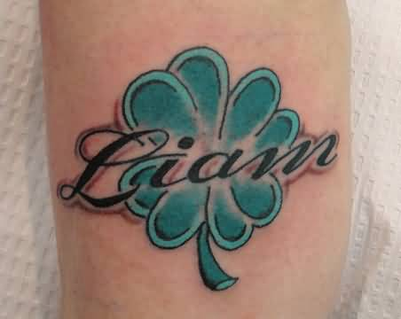 Nice Black Ink Name Text With Shamrock Tattoo