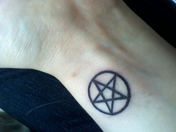 Nice Black Ink Pegan Symbol Star In Small Circle Tattoo