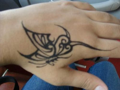 Nice Butterfly Scarification Tattoo Idea On Hand