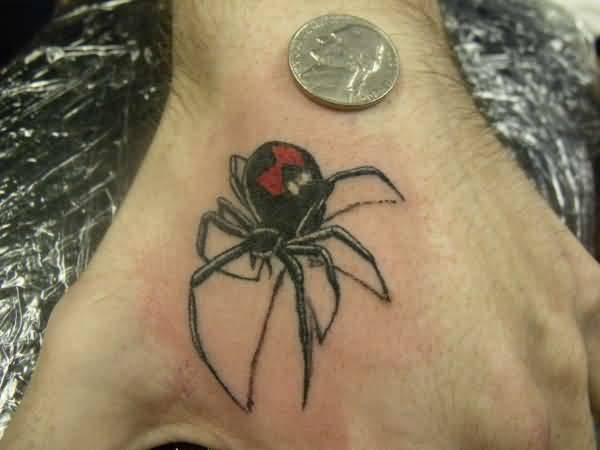 Nice Coin With Fantastic Black Widow Tattoo On Side Hand