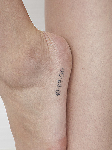 Nice Date Small Numbers Tattoo On Side Foot